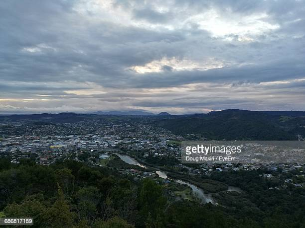 high angle view of cityscape against cloudy sky - whangarei heads stock-fotos und bilder