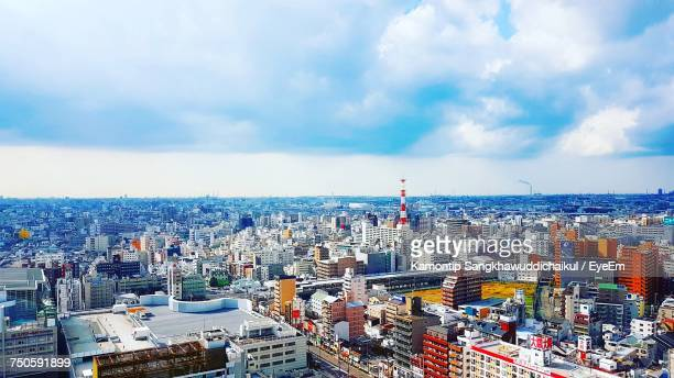 high angle view of cityscape against cloudy sky - region kinki stock-fotos und bilder