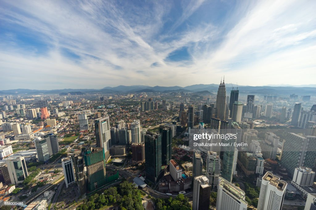 High Angle View Of Cityscape Against Cloudy Sky : Stock Photo