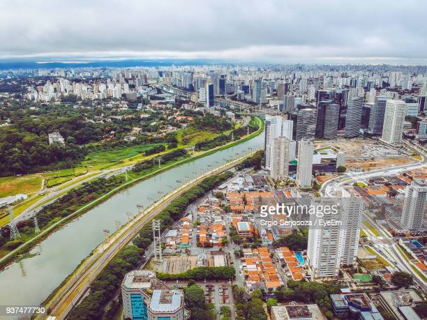 high angle view of cityscape against cloudy sky - assis ストックフォトと画像