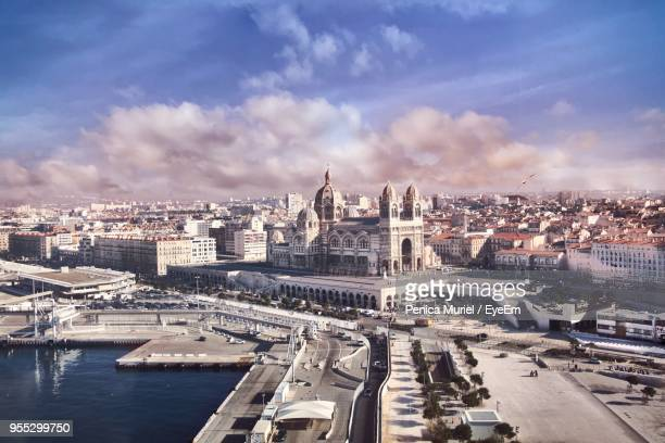 high angle view of cityscape against cloudy sky - marseille photos et images de collection