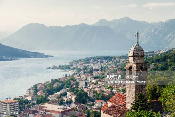 high angle view of cityscape against mountain - montenegro stock-fotos und bilder