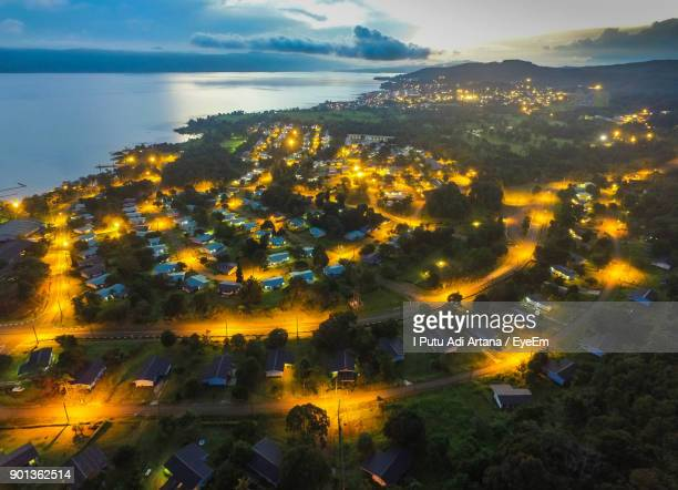 high angle view of cityscape against sky at night - makassar stock pictures, royalty-free photos & images