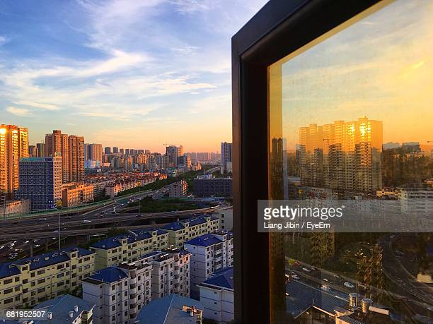 High Angle View Of Cityscape Against Sky At Sunset