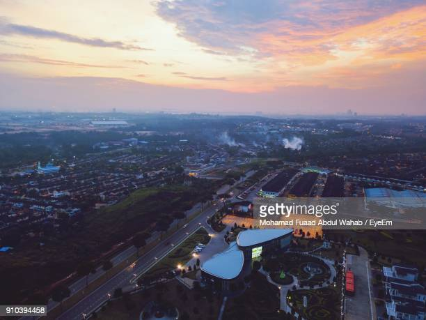 High Angle View Of Cityscape Against Sky During Sunset
