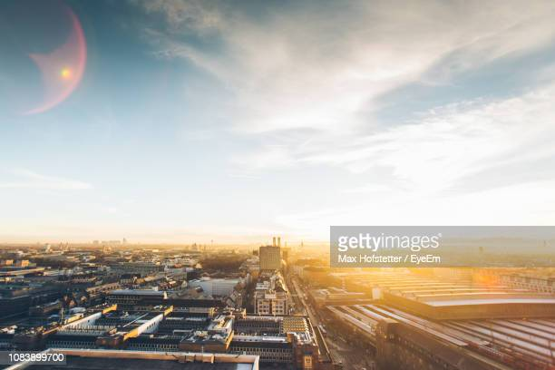 high angle view of cityscape against sky - sunlight stock-fotos und bilder