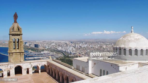 high angle view of cityscape against sky - oran algeria photos et images de collection