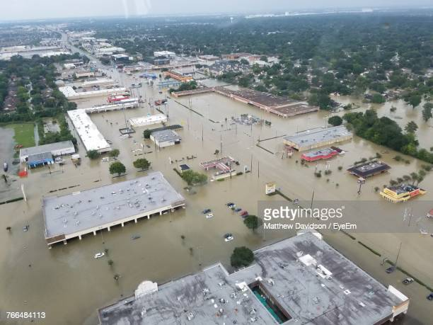 high angle view of cityscape against sky - flooding stock photos and pictures