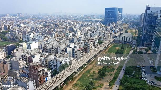 high angle view of cityscape against sky - ハリヤナ州 ストックフォトと画像
