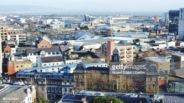 high angle view of cityscape against sky - swansea stock pictures, royalty-free photos & images