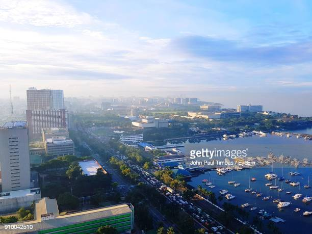high angle view of cityscape against sky - metro manila stock photos and pictures
