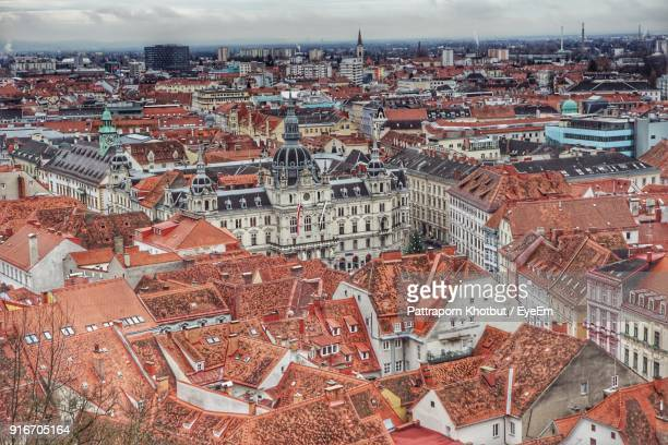 high angle view of cityscape against sky - graz stock photos and pictures