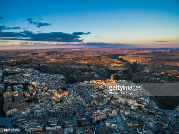 high angle view of cityscape against sky - matera stock photos and pictures