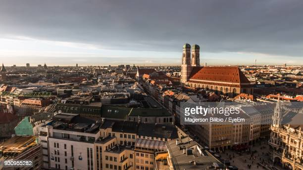 high angle view of cityscape against sky - münchen stock-fotos und bilder