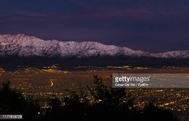high angle view of cityscape and mountains against sky - santiago chile stock pictures, royalty-free photos & images