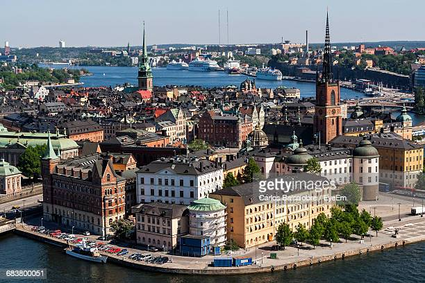high angle view of cityscape by river - riddarholmkirche stock-fotos und bilder