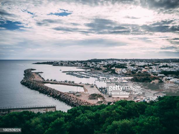 high angle view of cityscape by sea against sky - lecce stock-fotos und bilder