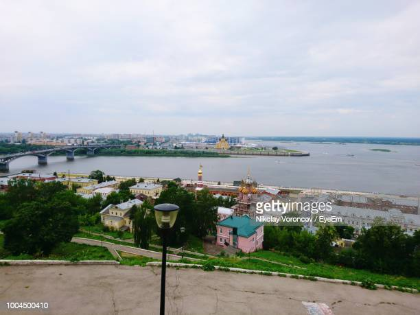 high angle view of cityscape by sea against sky - nizhny novgorod stock pictures, royalty-free photos & images