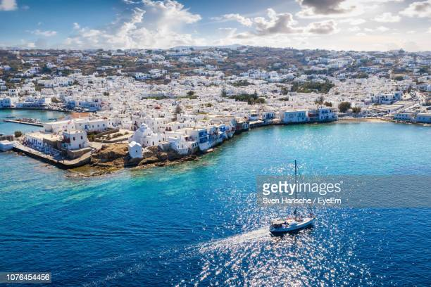 high angle view of cityscape by sea against sky - cyclades islands stock pictures, royalty-free photos & images