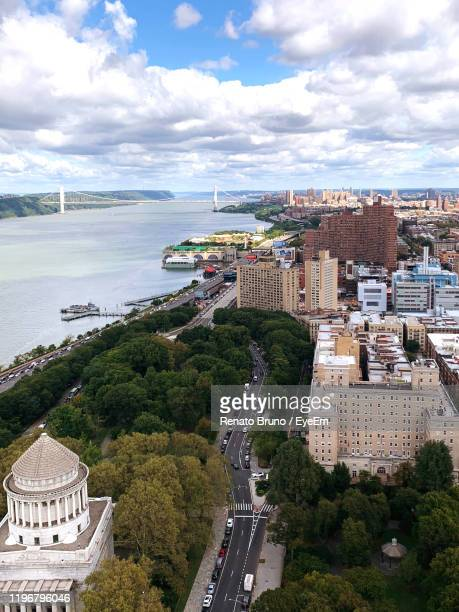 high angle view of cityscape by sea against sky - george washington bridge stock pictures, royalty-free photos & images