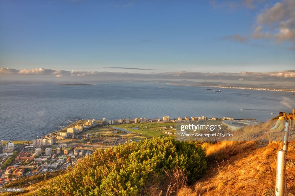 High Angle View Of Cityscape By Sea Against Sky : Stock Photo