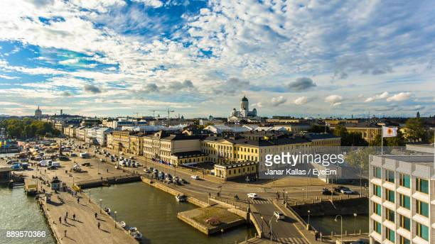 high angle view of cityscape by sea against sky - helsinki stockfoto's en -beelden