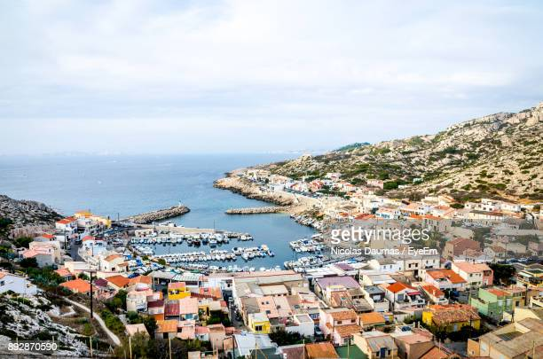 high angle view of cityscape by sea against sky - marselha - fotografias e filmes do acervo