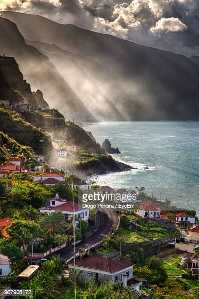 high angle view of cityscape by sea against sky - madeira stock photos and pictures