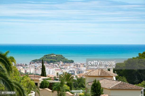 high angle view of cityscape by sea against sky - denia stock pictures, royalty-free photos & images
