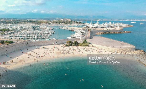 high angle view of cityscape by sea against sky - antibes stock photos and pictures
