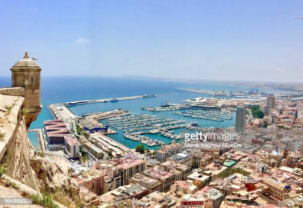 high angle view of cityscape by sea against sky - alicante stock pictures, royalty-free photos & images