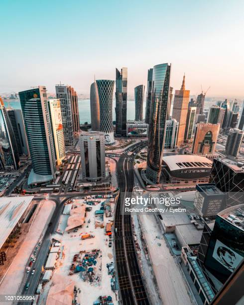 high angle view of cityscape during sunset - doha photos et images de collection
