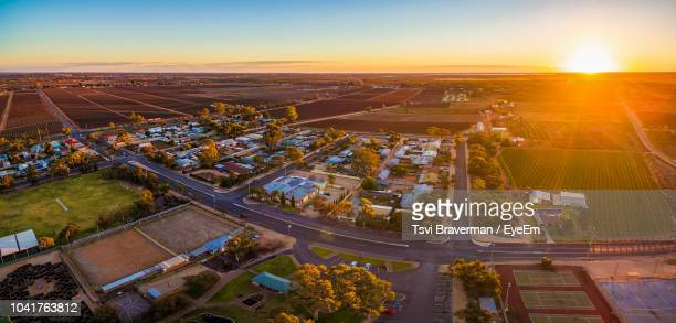 high angle view of cityscape during sunset - town stock pictures, royalty-free photos & images