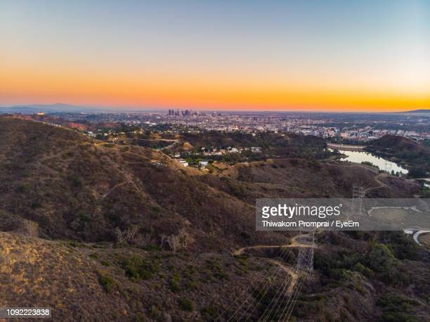 high angle view of cityscape during sunset - los angeles mountains stock pictures, royalty-free photos & images