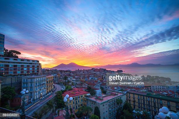 high angle view of cityscape during sunset - napoli stock pictures, royalty-free photos & images