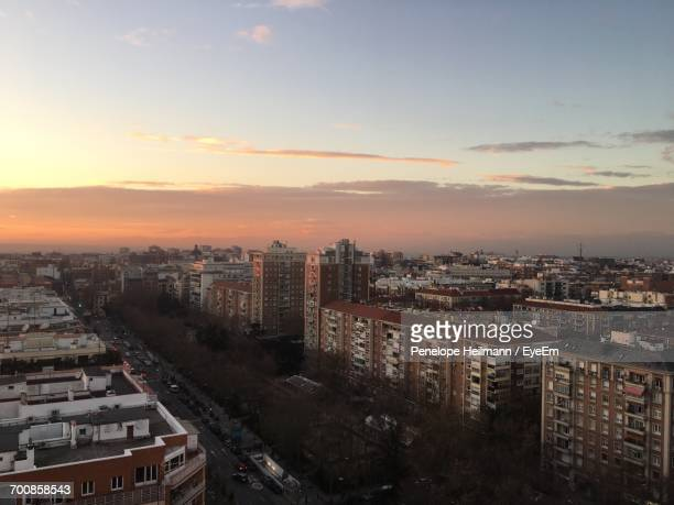 High Angle View Of Cityscape During Sunset