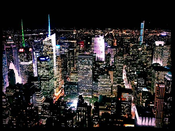 High Angle View Of Cityscape Lit Up At Night Wall Art