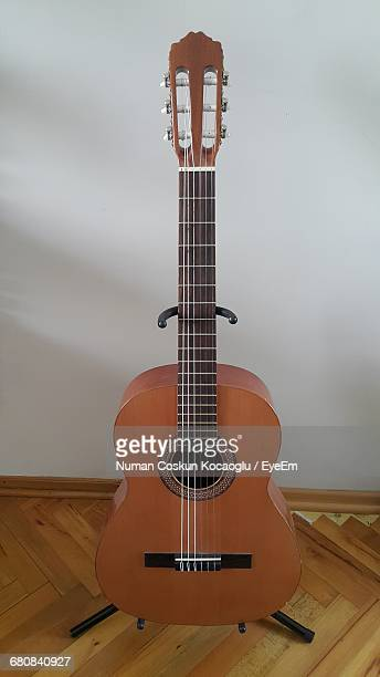 high angle view of classical guitar against white wall - classical guitar stock photos and pictures