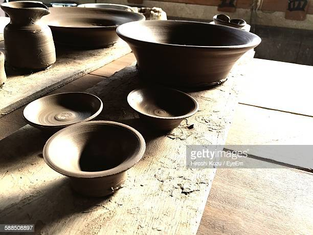 High Angle View Of Clay Pots Drying On Wooden Table