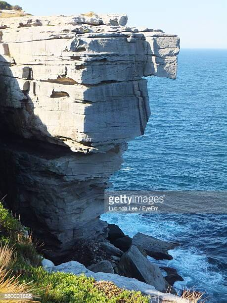 high angle view of cliff against sea - lucinda lee stock photos and pictures
