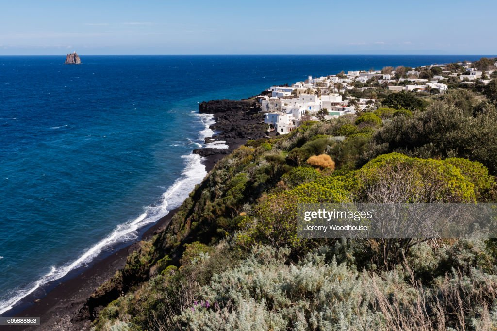 High angle view of cliff and ocean on Stromboli coastline, Messina, Sicily : Stock Photo
