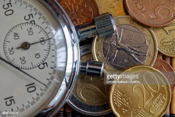 High Angle View Of Clock And Coins