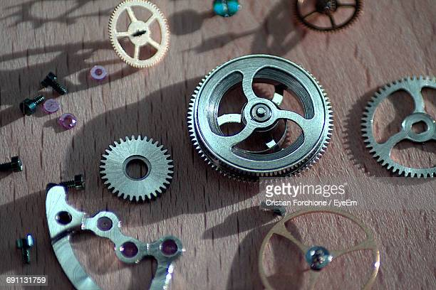 High Angle View Of Clock Parts On Table