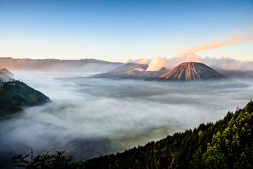 High angle view of clouds under smoking volcano - gettyimageskorea