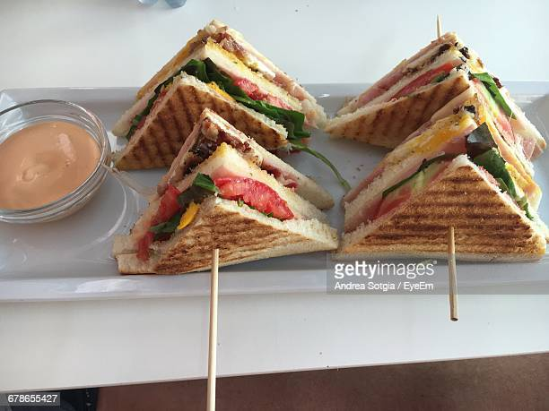 high angle view of club sandwiches with sauce served on table - club sandwich stock pictures, royalty-free photos & images