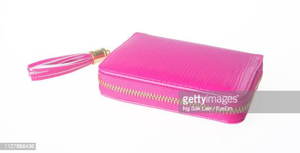 high angle view of clutch bag on white background - pochette borsetta foto e immagini stock
