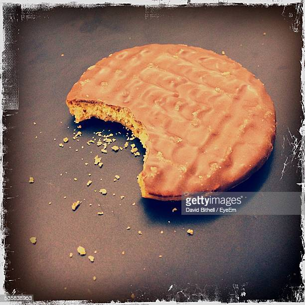 High Angle View Of Coated Cookie With Missing Bite