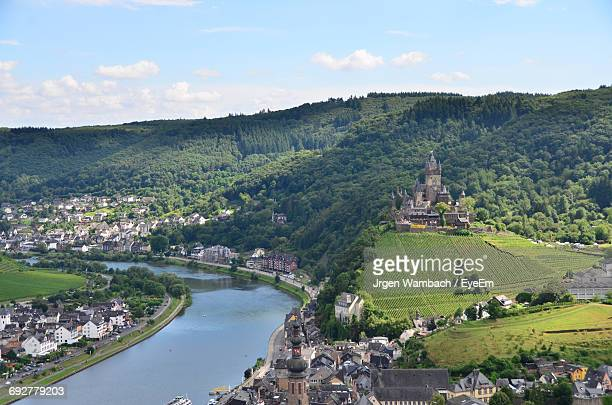 High Angle View Of Cochem Castle On Hill By River In Town