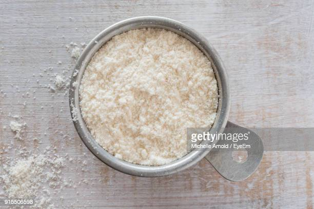 high angle view of coconut flour in bowl on table - flour stock pictures, royalty-free photos & images