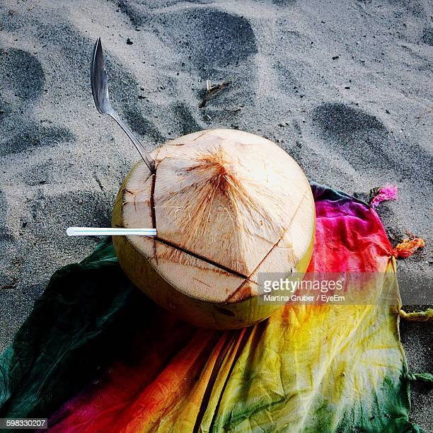 High Angle View Of Coconut On Sand At Beach